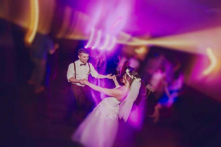 A bride and groom dancing