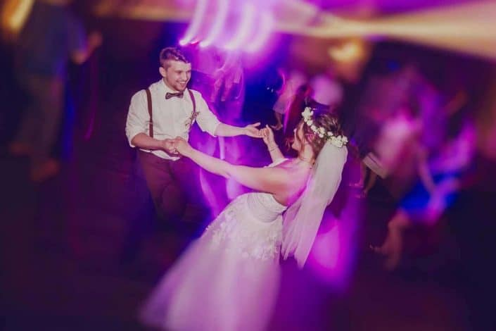 A bride and groom dancing