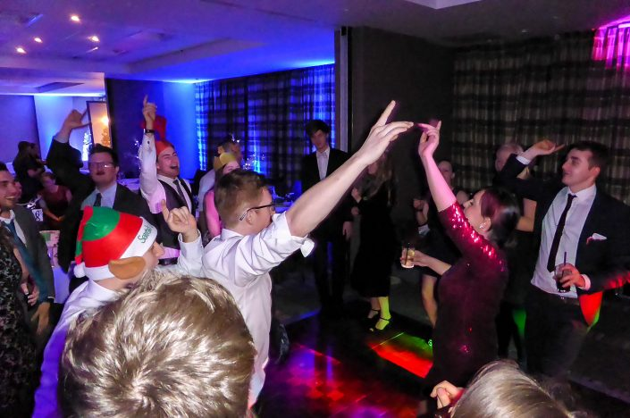 Audience dancing at a !daft! cover band Christmas party gig