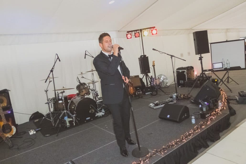 Singer Joe Fryd performing at a VIth form ball