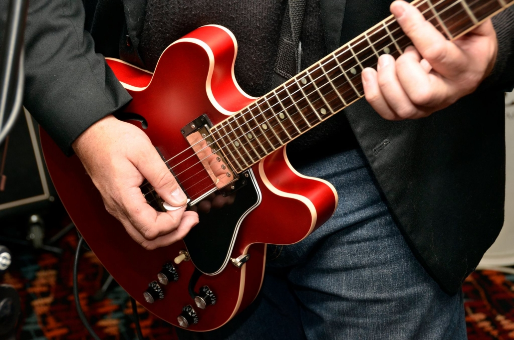 A guitar being played.